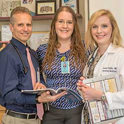 Internal Medicine Intern Anna Clarke MD with her sister, pediatrics resident Rachel Clarke, and Dr. Rosenblum